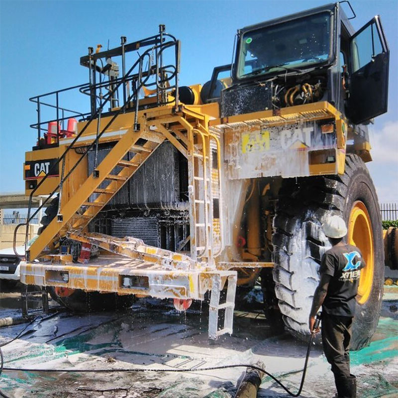 Cleaning Yellow Machinery for Export